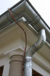 Galvanized Gutters & Downspouts - Notice the soldered joints at the gutters and downspout.