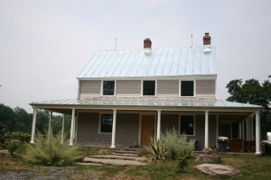 A new standing seam metal roof (galvanized) freshens up this updated farm house!