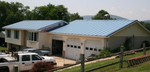 """A new standing seam metal roof (pre-painted """"Slate Blue""""). Just one of many different color choices available."""