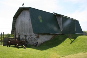 Newly painted barn roof. Wow! What a difference!