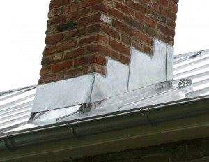 Typical step flashing detail tying into a new standing seam metal roof.