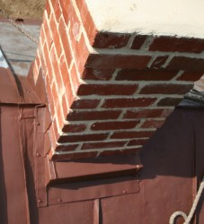 Sometimes, existing conditions can make chimney flashing quite complicated!