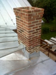 """""""Cricket"""" Flashing is used to shed water,snow or ice away from a chimney."""