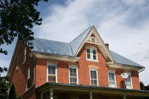 A new galvanized standing seam metal roof looks great on this Victorian style home.
